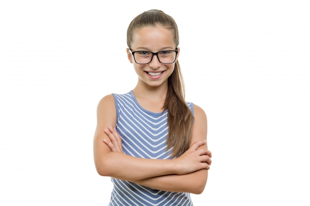 Confident young girl student in glasses with arms crossed