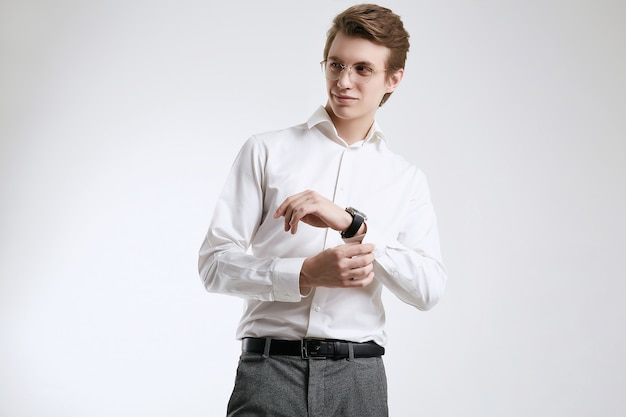 Confident young handsome businessman in shirt isolated on white background
