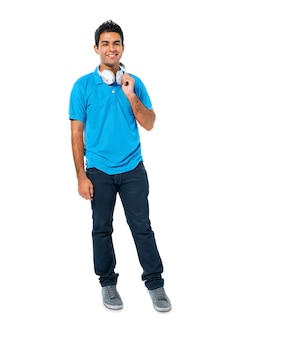 Confident young man standing and smiling