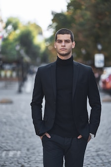 Confident young man walking on a european city street
