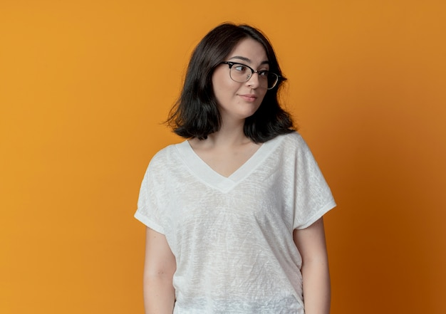 Confident young pretty woman wearing glasses looking at side