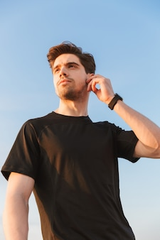 Confident young sportsman in black t-shirt