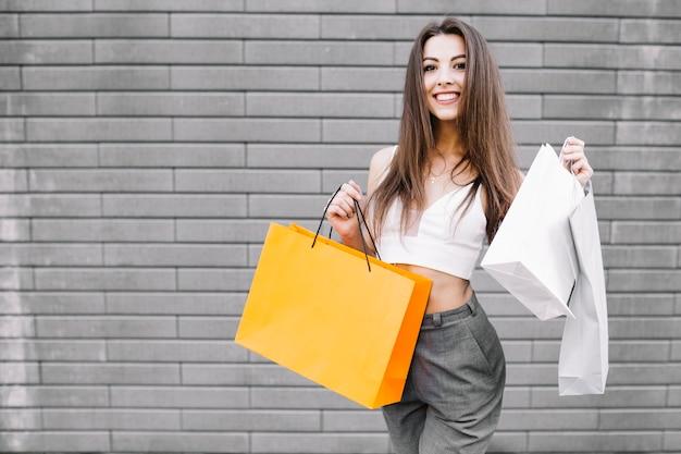Confident young woman enjoying buying