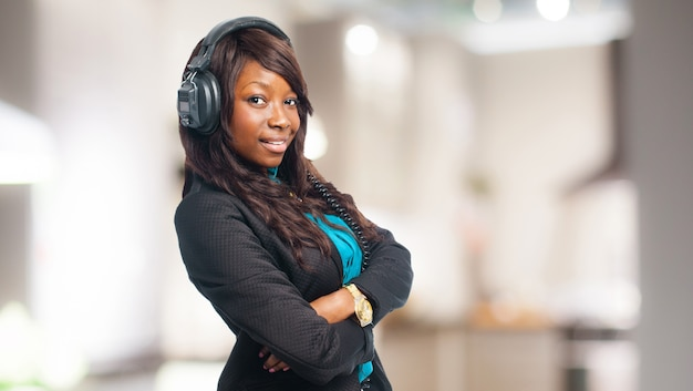 Confident young woman listening to music with headphones