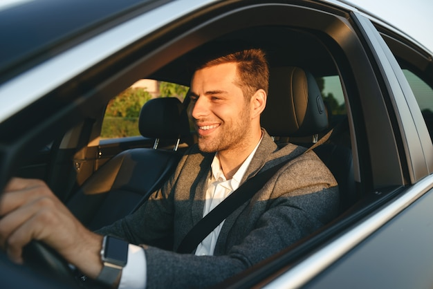 A happy man in an insured car