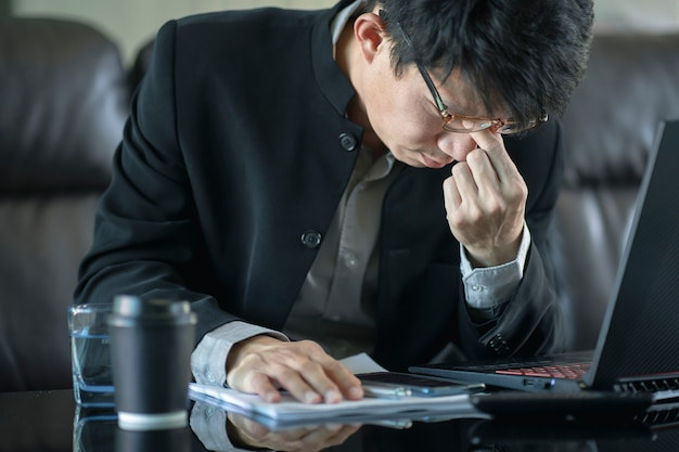 Confused businessman with stressed and worried about  working mistake and problems.