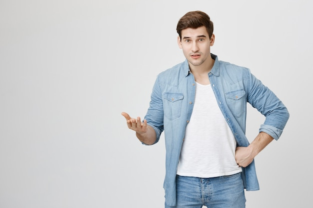 Confused man can't understand, raise hand frustrated
