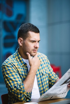 Confused man reading news