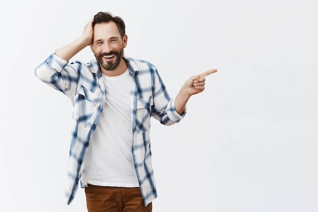 Confused and shocked bearded mature man posing
