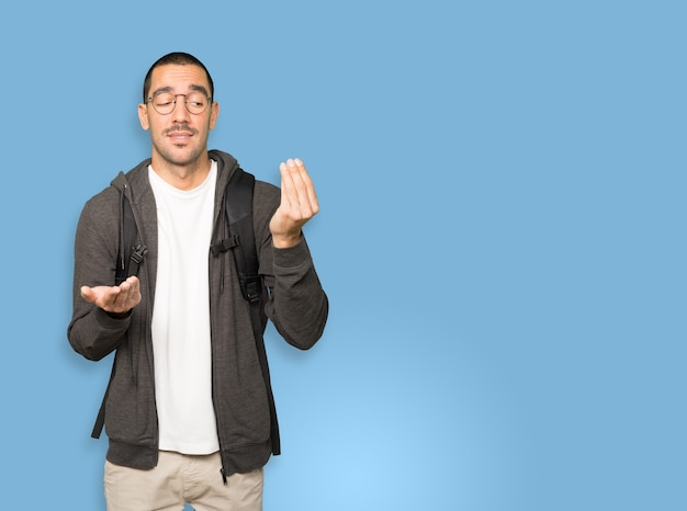 Confused student making an italian gesture of not understand