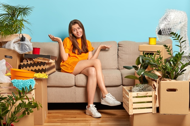 Confused unhappy woman moves in new house