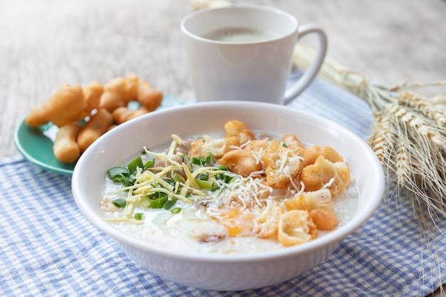Congee  boiled egg with soy milk and chinese deep fried double dough stick
