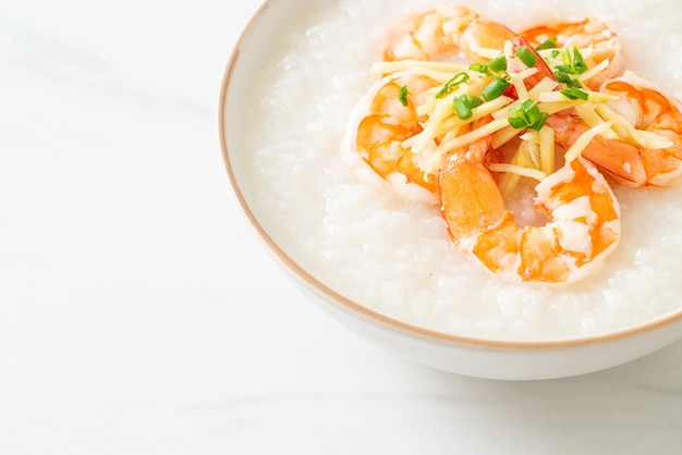 Congee with shrimps and fresh ginger on top