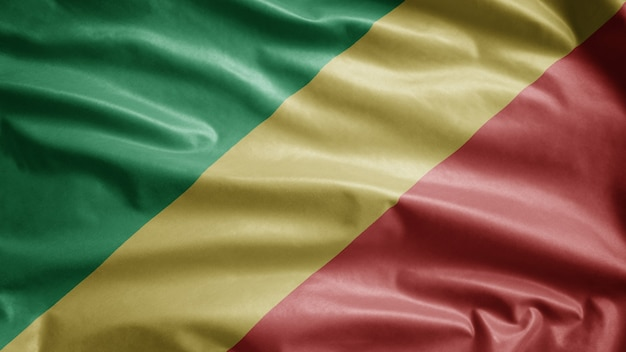 Congolese flag waving on wind. close up of republic of congo banner blowing, soft and smooth silk