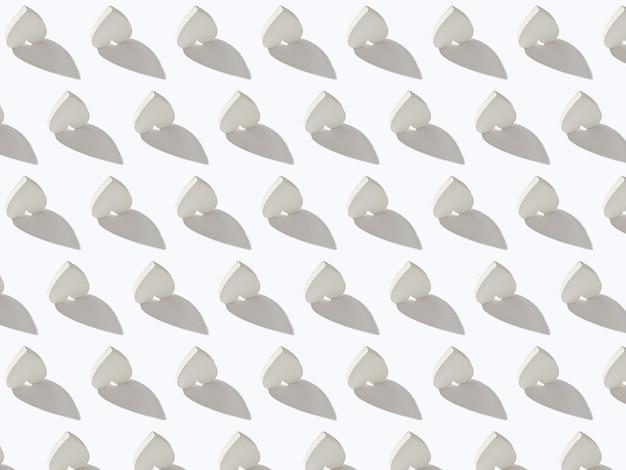Поздравительный творческий узор из перевернутых сердечек из гипса на светло-серой стене с жесткими тенями. валентина