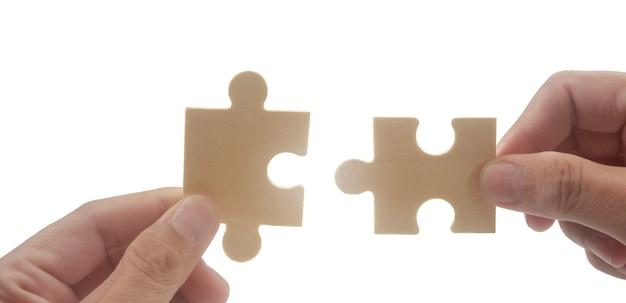 Соединение головоломки в руке успех бизнес-решений и концепция стратегии