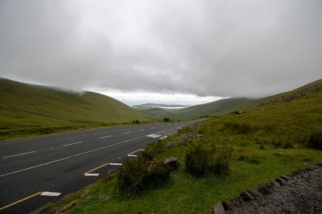 Connor pass with dramatic sky, dingle peninsula, county kerry, ireland