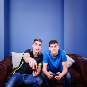 Console gamers on couch