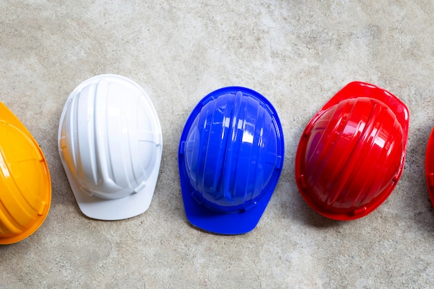 Constructi on helmets on concrete background.