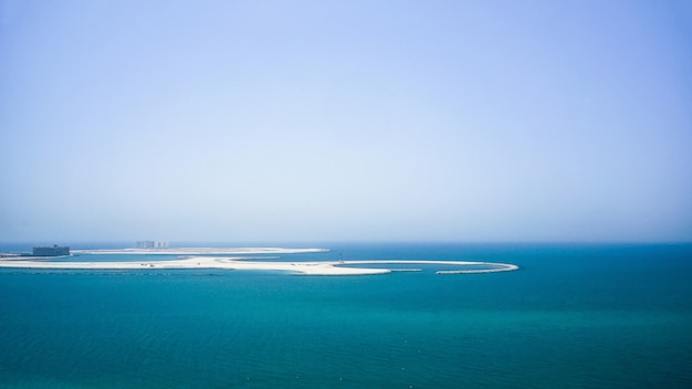 The construction of the artificial islands of palm jumeirah in the arabian gulf. dubai.