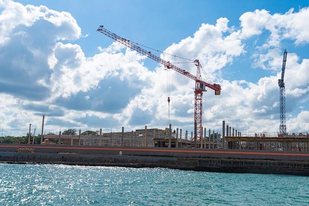 Construction on the beach. cranes against the sky.