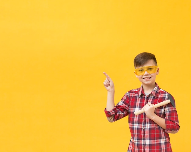 Construction boy pointing at copy space