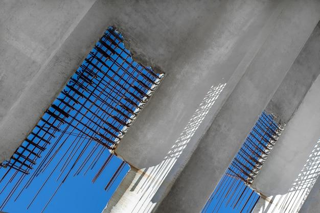 Construction of the bridge. concrete blocks with reinforcement against the sky.