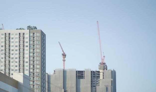 Under construction building incurs view against sky