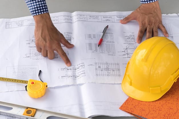 Construction concept , hands of engineer working on blueprint
