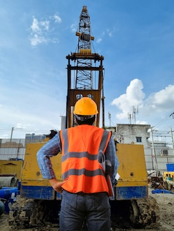 Construction control engineer cranes on the construction site area industry machine of drilling piles