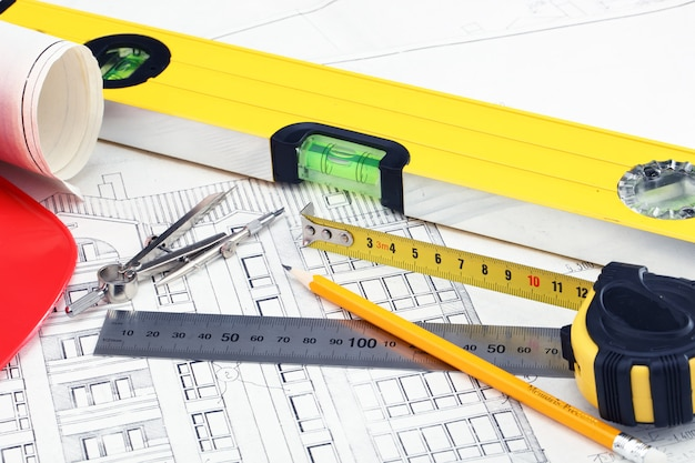 Construction drafts and tools on the table