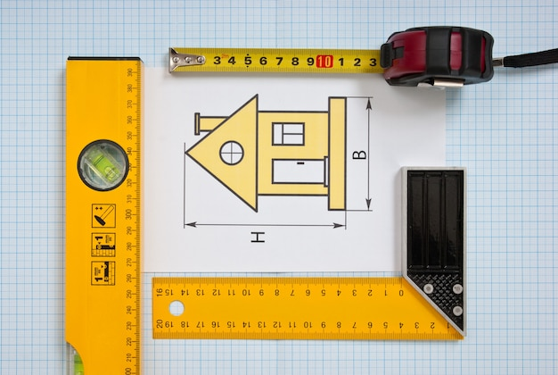 Construction drawings and tools on graph paper