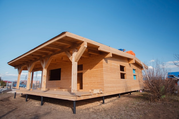 The construction of ecological wood homes. mortgage, loan, dream house. country private house