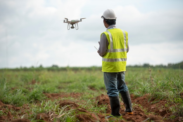 Construction engineer control drone  survey land for real estate development