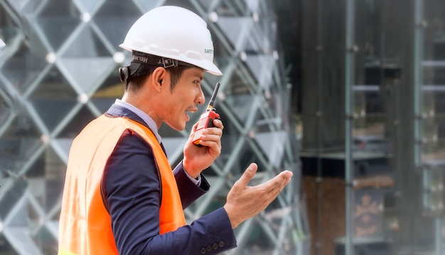 Construction engineer talking on radio.construction engineer use radio communication.