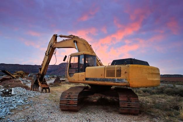 Construction excavator at sunrise