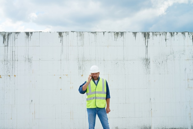 Construction foreman calling by phone