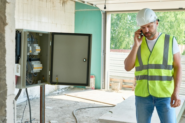 Construction foreman speaking by phone