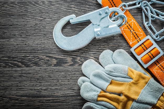 Construction gloves safety strap on vintage wooden board
