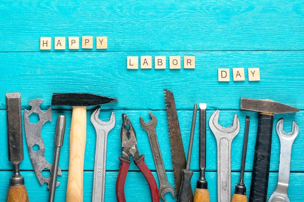 Construction group home tools on blue wooden background