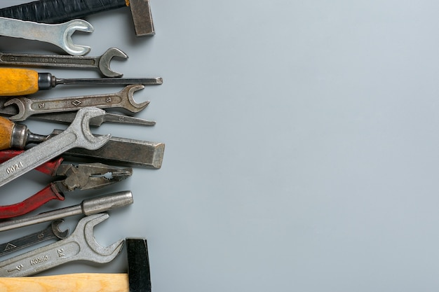 Construction group home tools on gray background
