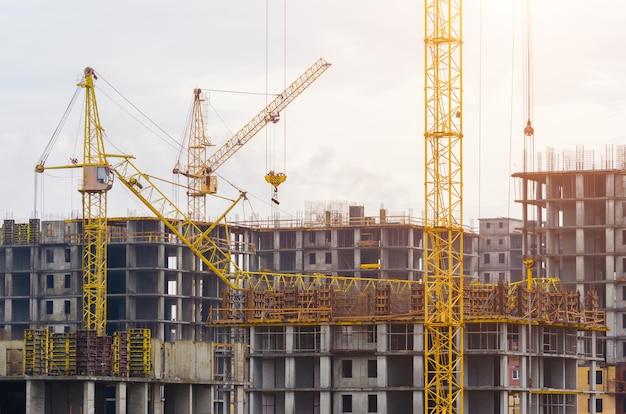 Construction of houses cranes, crash crane crash on the building