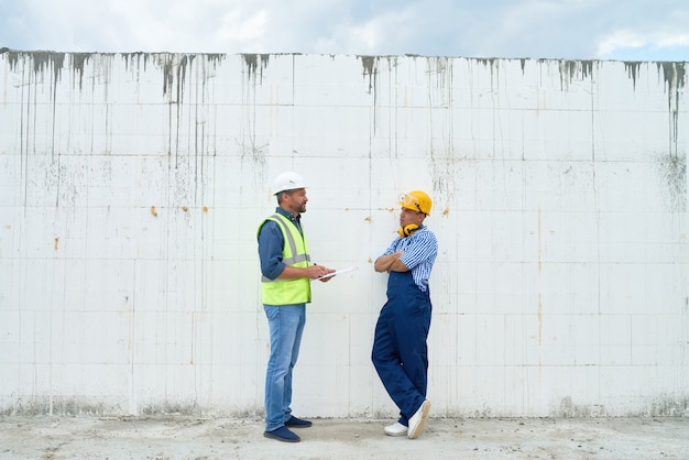 Construction inspector talking to foreman