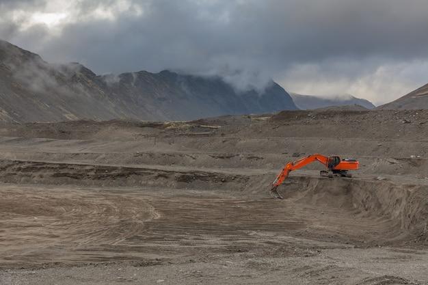 Construction machinery works on quarry mining in the khibiny mountains, kola peninsula