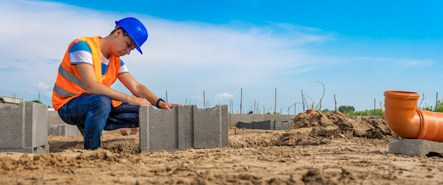 Construction manager on the construction of the foundation of the building, bunner with copy space