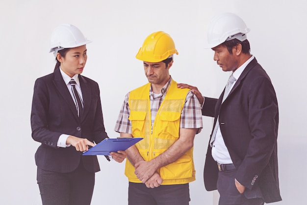 Construction manager and engineer talking