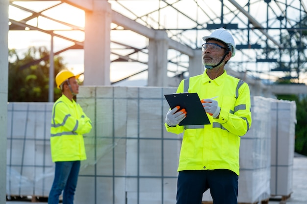 Construction manager and engineer working on construction site