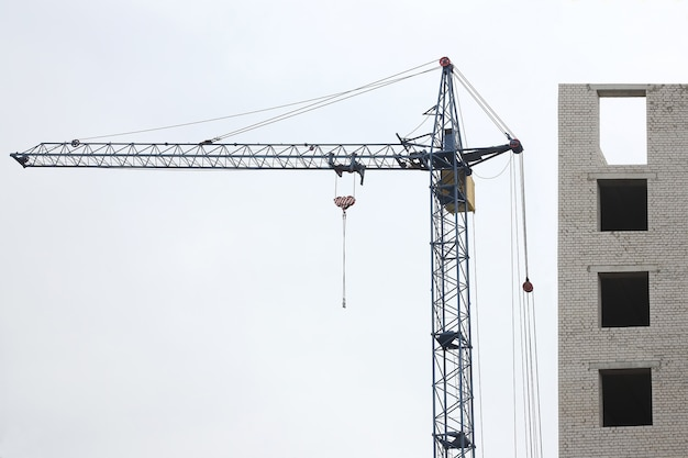 Construction of a multi-story building with a construction crane