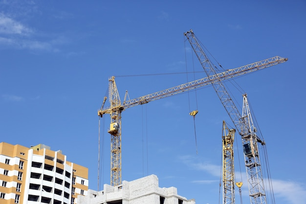 The construction of a multistory building with construction crane