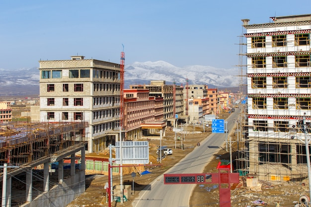 Construction new city at china southwes, tibet under snow mountain, sichuan, china